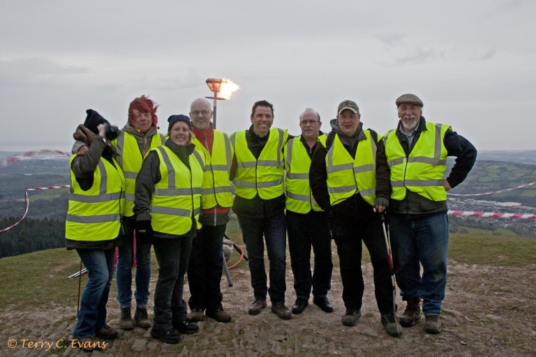 Lighting a beacon on the summit of Twmbarlwm, south Wales, to celebrate the Queen's 90th birthday 21/04/2016